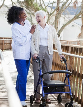 caregiver and woman with walker