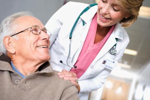 older man visiting female geriatrician