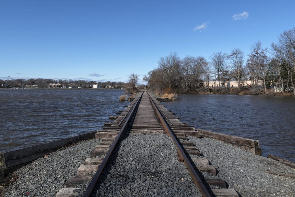 Railroad tracks cross Manalapan Lake in Thompson Park in Middlesex County New Jersey.